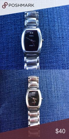 Fossil stainless steel ladies watch Fossil stainless steel ladies watch. Diamond 12 o'clock feature. Needs battery. Couple faint scratches on face but nothing. Noticeable Fossil Accessories Watches