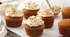 Pumpkin Cupcakes with Almond Cream Cheese Frosting: These cinnamon-spiced pumpkin cupcakes are topped with a generous mound of  fluffy almond cream cheese frosting and toasted almonds.