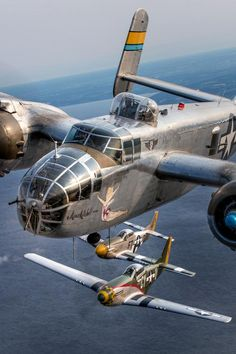 North American B-25 Mitchell bomber Miss Mitchell flanked by a pair of North American P-51 Mustangs, Gunfighter (foreground) and Angel's Playmate.