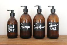 Amber Glass Bottles Bathroom Essentials Set With Labels. Brown Glass Bottles, Amber Glass Bottles, Glass Jars, Bathroom Spa, Glass Bathroom, White Bathroom, Bathroom Essentials, Perfume, Bath Decor
