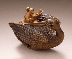 Daoist Immortal with Crane, 19th century  Netsuke, Wood with staining, inlays