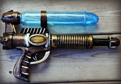 Made from a dollar store water gun. I used black gesso to prime then Rub'N'Buff polish for metallic colour and sealed with a water based varnish. Put glow sticks in the barrel to give it a special glow.