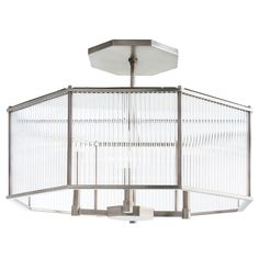 Hera Octagon Chandelier is a modern interpretation of the purity of form of Greek and Roman columns. Clear glass cylinders to create unique lighting, accenting the Vintage Silver or Antique Brass finish. Includes one 6 inch and two 12 inch rods. Four 60 watt, 120 volt B10 Candelabra base incandescent bulbs are required, but not included. 30 inch width x 12 inch height x 43.5 inch maximum length. UL listed. Damp rated.