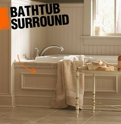 A bath tub surround most often refers to the wooden or tile surface where the edges of a drop-in bathtub meet the floor.