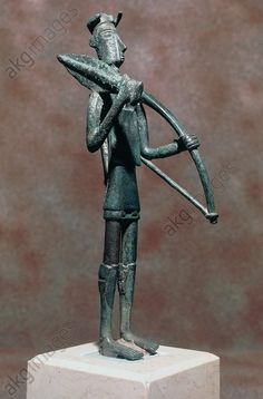 Warrior with sword and bow, bronze statue, height 24 cm, from Monte Arcosu, Uta, Sardinia, Italy. Nuragic civilisation, 8th–5th century BC. Cagliari, Museo Archeologico Nazionale (Archaeological Museum)