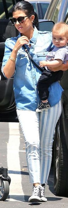 Who made Kourtney Kardashian's black sneakers, gold jewelry, and white striped jeans?