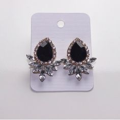 """Black/Clear Crystal Earrings Perfect earrings to pair with that little black dress.  Black and clear crystals set in silver tone metal.  Nickel and lead free.  Measurements:  1 & 1/2"""" L & 1 & 1/8"""" W.  Photo courtesy of Iconic Legend.  Price is firm unless bundled.   Iconic Legend Jewelry Earrings"""