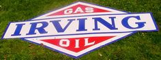 Large die-cut sign for Irving Gas & Oil.