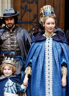 Robbie Fisher as Louis XIV & Alexandra Dowling as Anne of Austria in The Musketeers (2014-)