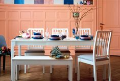 IKEA white EKEDALEN dining table with white EKEDALEN bench and bright colours.