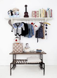 open shelf with hanging rod for sweet clothes to display. - Line Klein photo