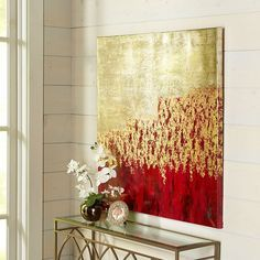 """Though we've titled it """"Unassuming,"""" our remarkable, hand-painted canvas will have quite an impact on your living, dining or bedroom areas. With its interplay of red, gold and silver, this artwork is ready to bring a dramatic counterpoint to modern and traditional styles alike."""