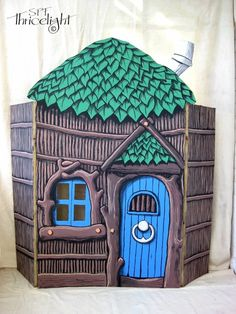 The three little pigs stick house. Painted cardboard with acrylic paints. Great for acting out the story!