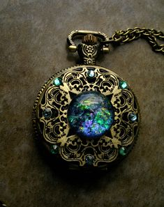 Pocket Watch - Dream Drop - Opal like green orange purple pink blue - Color Shift - Steampunk Timepiece Gothic - All Seeing Eye - Color Shifting GLOW Betwixt Regal - Orange And Purple, Purple Gold, Pink Blue, New Electronic Gadgets, Uv Black Light, Eye Color, Pocket Watch, Swarovski Crystals, Steampunk