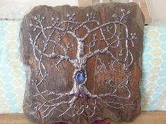 """Florida Celtic Art - Commission piece...hand-embossed pewter tree of life with letter """"S"""" unitial and blue stone embellishment in heart of tree. Metal mounted on hand-chipped slate. Overall size 16"""" x 16"""" (approx due to the irregularities of the natural stone)  #pewter #embossed #embossedmetal #slate #treeoflife  #tree #heart #celticheart #blue #stone #commission #celticartwork #celticknot #Florida #CelticArt"""