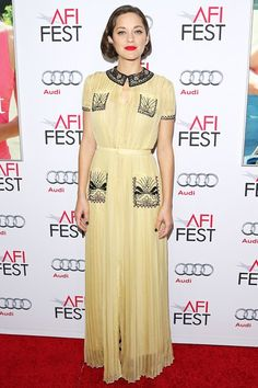 Marion Cotillard wore a Valentino spring/summer 2015 gown.