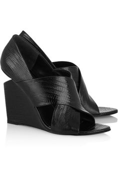 Wedge heel measures approximately 110mm/ 4.5 inches Black patent-leather Slip on