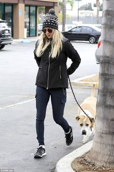 Animal lover: Kaley Cuoco was spotted taking her pet dog Norman to the animal hospital in Los Angeles on Monday