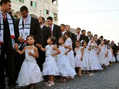 """""""We are presenting this wedding as a gift to our people who stood firm in the face of the siege and the war,"""" local Hamas strongman Ibrahim Salaf said in a speech. Read more at http://www.snopes.com/photos/politics/masswedding.asp#bbDELQKVbQ8xK6Q7.99"""