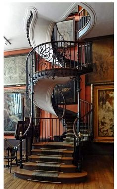 A wrought iron, spiral staircase that looks like a ribbon. Beautiful. Fan, Home Appliances, Table, House Appliances, Domestic Appliances, Tables, Desk, Desks