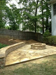Dry Stack Fieldstone Wall / Bench And Fire Pit. Mosaic Flagstone Patio.