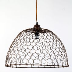 Chicken Wire Basket Pendant Lamp from Barn Light Electric (http://www.barnlightelectric.com/pendant-lighting/apartment-lighting/chicken-wire-basket-pendant-lamp.html)