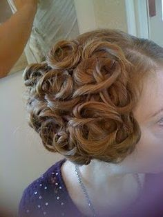 It's like cinnamon buns! On your head! Awesome! haha What every bride should be wearing on her head.