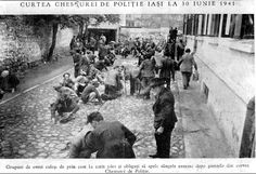 Jews in front of the Police Station Building in Iasi, Romania, being forced to scrub the street pavement in cleaning up the Jews blood.  (June 30, 1941)
