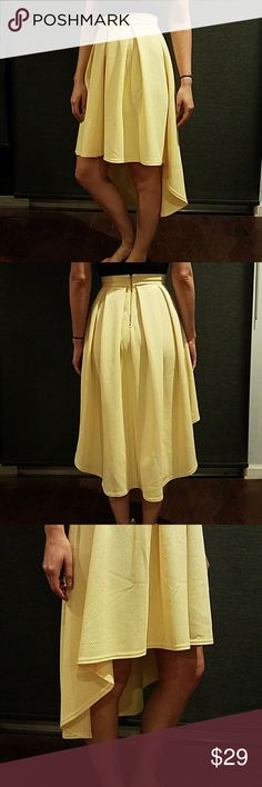 HIGH LOW SKIRT HIGH LOW SKIRT COLOR/YELLOW  ZIPPERS IN THE BACK SUPER COMFY  GOOD FOR DAY OR NIGHT! Skirts High Low