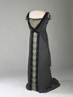 Evening Dress, House of Worth 1915, American, Made of satin~~~Black charmeuse satin trimmed with beads, black velvet, and white net, from the House of Worth in Paris. The first lady wore the dress in 1915 for a private dinner party at the White House. Worn by First Lady Edith Wilson.