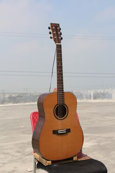 """$112 Model:W-MCS-41D Name:41"""" Solid Top Acoustic Guitar Top:A+ Solid Cedar Back & Side:Ebony Binding:ABS+Maple Back Seam:Wood Rosette:Wood Finish:High-gloss Color:Nature    Neck Material: Nato Fingerboard:Rosewood with Inlay Abalone Shell Dot Fret:20 Nut:Bone Nut Width:1 3/4"""" (43mm)                           Bridge:Rosewood Head machine:High Quality Black Die-cast Saddle:Bone Strings:D'Addario EXP 16 Electronics:As you requested Avaliable Service:Wholesale/ODM/OEM"""