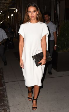 September 2016 Alba made a case for minimalistic dressing with simple golden accessories, a white dress and a pair of black Pierre Hardy sandal heels.