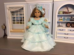 Just stunning - Victorian style dress with matching jewelry for your 18 inch American Girl Doll (Elizabeth, Marie-Grace, Felicity, Caroline, etc.). The dress is made with high quality aqua color satin and matching chiffon. The skirt features 3 layers of chiffon ruffles, each ruffle