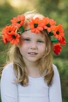 paper flower crown, photo by Anahi Navarro http://ruffledblog.com/whimsical-austin-wedding #orange #flowergirls #floralcrown