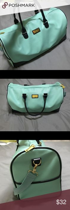 """Nicole Miller Overnight Bag Super cute turquoise and black with gold hardware overnight bag is brand new. The lining is a sexy little animal print with lots of zipper storage compartments. Comes with a shoulder strap too. It measures approximately 20"""" long, 12"""" high and the base is 9"""" wide. Nicole Miller Bags Travel Bags"""
