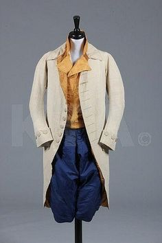A gentleman's ensemble, late 18th century, comprising: ivory silk coat with pointed rear collar, narrow curving sleeves, diapered silk covered buttons, lined in dark mustard twill silk and linen, one functioning buttonhole, c.1780-90; a striped orange silk double-breasted waistcoat with mother of pearl buttons, with wide angular lapels c.1790; and a pair of sapphire blue silk breeches, with front-buttoning flies, wide fall, pocket to right hip, 1760s-70s