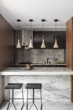 Dark wood contrasts pale marble at renovated Brazilian apartment