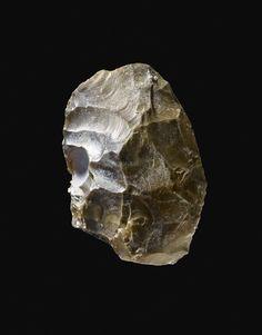 Flint biface. Cleaver form. Bifacial tranchet removals form transverse end. England,Essex,Thurrock,Aveley