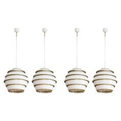 Set of Four Alvar Aalto 'Beehive' Ceiling Lamps Model No. A 331   From a unique collection of antique and modern chandeliers and pendants at https://www.1stdibs.com/furniture/lighting/chandeliers-pendant-lights/