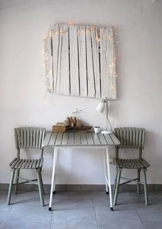 sania pell - white-washed wood + twinkle lights + table