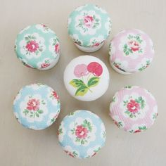 Shabby Chic Drawer Pulls - decoupage pretty fabric or a napkin on plain drawer pulls - these are so pretty!