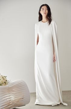 Wedding Dress Vintage Stella McCartney Cape Sheath Gown - Find and compare Stella McCartney Violet Cape Wedding Dress across the world's largest fashion stores! Simple Wedding Gowns, Minimalist Wedding Dresses, Classic Wedding Dress, Wedding Dress Cape, Chanel Wedding Dress, Gown Wedding, Red Wedding, Budget Wedding, Wedding Shoes