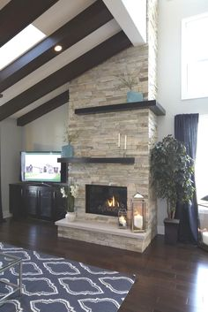 2013 Birchwood Parade Home, floor to ceiling stacked stone gas fireplace. 2013 Birchwood Parade Home, floor to ceiling stacked stone gas fireplace. Simple Fireplace, Fireplace Hearth, Home Fireplace, Fireplace Remodel, Living Room With Fireplace, Fireplace Surrounds, Fireplace Design, Fireplace Ideas, Modern Stone Fireplace