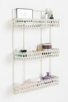 WHITE TRIPLE SHELF by URBAN OUTFITTERS This sturdy enameled metal hanging wall shelf features three shelves for maximum storage and predrilled holes at the top sides for wall placement; finished with charming punch-out design. Storage Shelves, Wall Shelves, Shelving, Ikea Shelves, Smart Storage, Book Shelves, Hidden Storage, Urban Outfitters, Office Deco