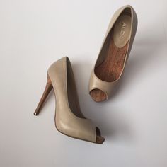 """ALDO Tan Heels with Cork Accents A classic silhouette on a gorgeous heel! Only worn once!! Slip on, almond toe / peep toe, platform shoe. Heel height is 5"""", platform height is 1/2"""". Heel is cork-like and also has a cork-like insole. Outer material is a beige color with a gray-like color lightly mixed on it. Last picture shows a spot of teeny tiny nicks. ALDO size 38 = 7 1/2 US size. NO TRADES. ALDO Shoes Heels"""
