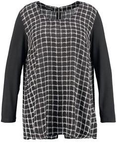 De vleiende blouse gemaakt van vloeiende, gedrukte viscose met fijne textuur. Elegante A-lijn stijl met comfortabele jersey mouwen en rits op de rug. ...