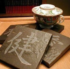 KANJI COASTERS SET - Carved Natural Slate Stone - Asian Symbols - Faith Love Health Prosperity. $29.00, via Etsy.