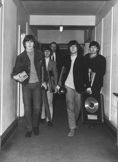 The Beatles and George Martin with another gold record
