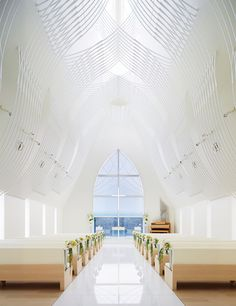 Slate-clad chapel by Eriko Kasahara boasts a veil-inspired ceiling structure.