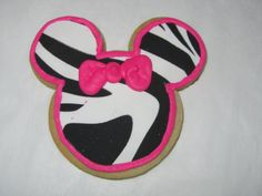 Minnie cookie made with Wilton zebra sugar sheet and pink royal icing